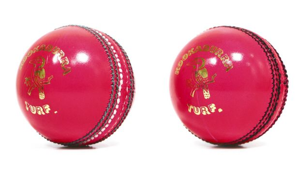 Old and new: the latest pink ball (right) has black stitching instead of green and white.