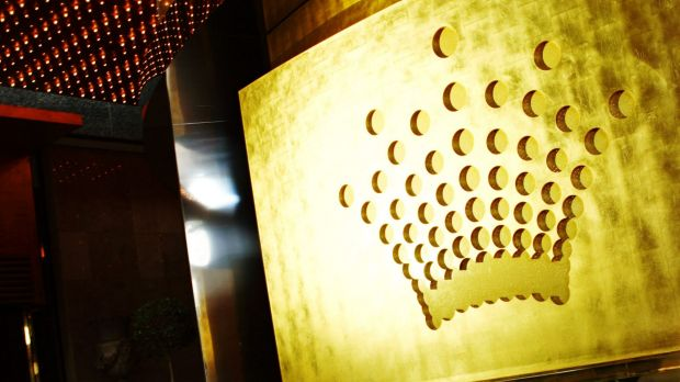 The accused man was escorted from the gaming floor of Crown Casino.