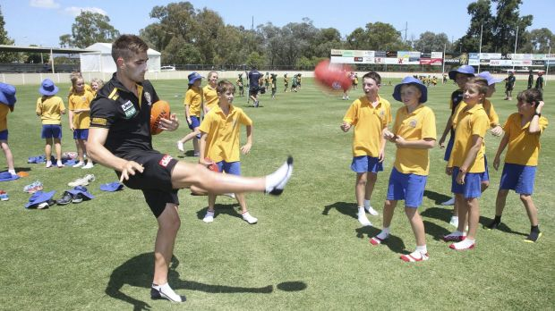 Richmond midfielder Anthony Miles at a football clinic in Albury on Tuesday.