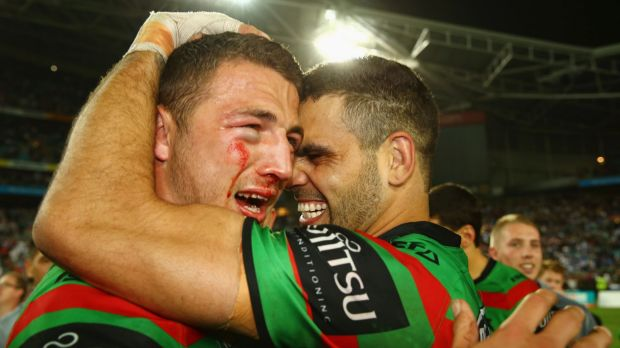 Back together: Sam Burgess and Greg Inglis celebrate winning the 2014 NRL grand final. Burgess has returned to Redfern ...
