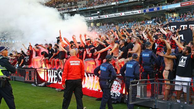 Wanderers fans let off flares during the round 18 match against Melbourne Victory.