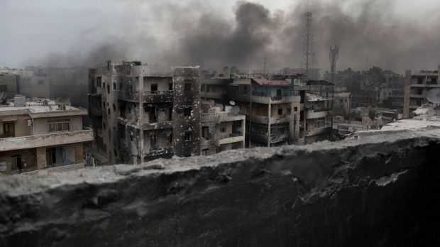 Smoke rises over Aleppo, once Syria's commercial capital and a tourist magnet.