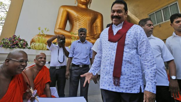 Former Sri Lankan President Mahinda Rajapaksa talks to Buddhist monks at a function organised last week to sign a ...