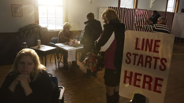 Voters arrive to cast their ballots in the first-in-the-nation New Hampshire presidential primary at the Chichester Town ...