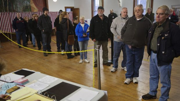 Voters wait in line at the Chichester Town Hall in Chichester, New Hampshire.