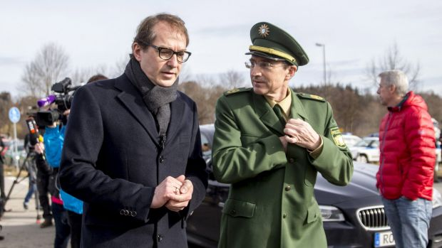 German Transport Minister Alexander Dobrindt arrives at the crash site near Bad Aibling, Bavaria, on Tuesday.