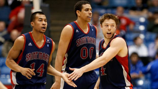 College days: Stephen Holt with St Mary's Gaels teammates Brad Waldow and Matthew Dellavedova during a game against the ...