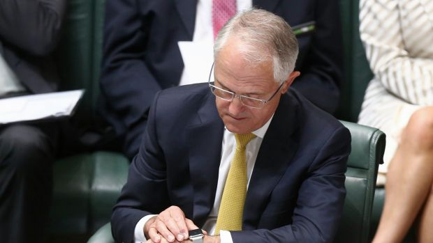 Prime Minister Malcolm Turnbull checks his watch during question time on Wednesday.