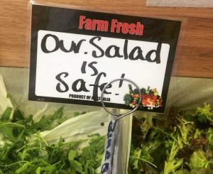 A supplier delivers a positive message about salads at the Prahran Market in Melbourne.