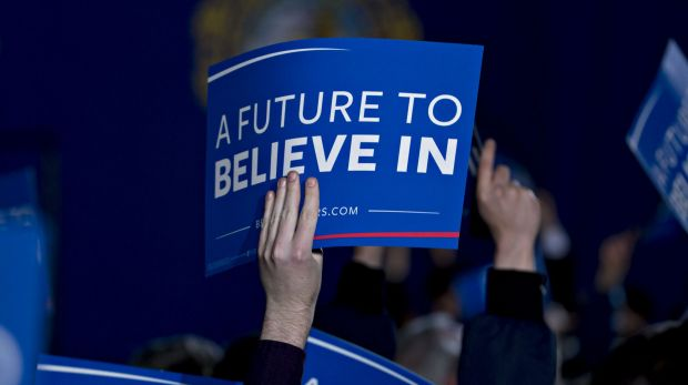 Attendees hold up signs for Vermont senator Bernie Sanders in New Hampshire.