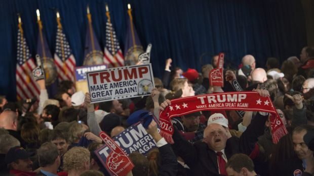Trump supporters celebrate winning the New Hampshire primary.