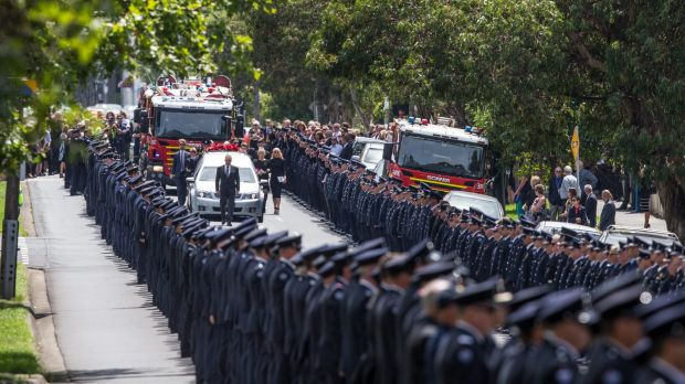 Hundreds of fireman form a guard of honour for the funeral of Damien Burke.