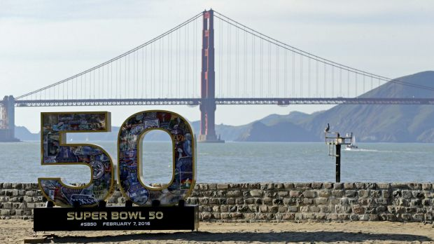 A Super Bowl 50 sign rests on the beach near the Golden Gate Bridge in San Francisco. Seven teenagers were rescued from ...
