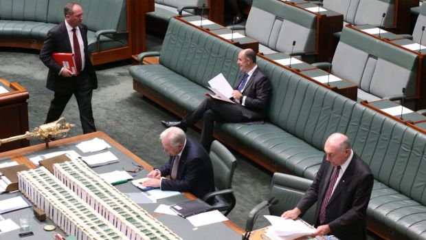 Deputy Nationals leader Barnaby Joyce walks in to join fellow frontbenchers Andrew Robb Minister, Stuart Robert and ...