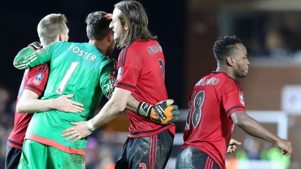 West Bromwich Albion goalkeeper Ben Foster is congratulated by teammates at the end of the penalty shootout.