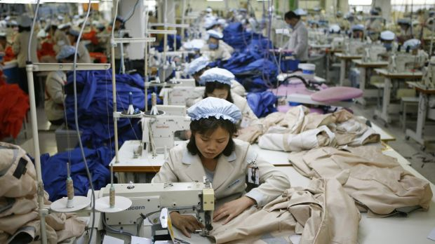 North Korean workers assemble jackets at a factory of a South Korean-owned company at the jointly-run Kaesong Industrial ...