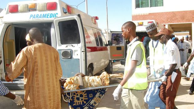 Rescue workers transport a victim of a suicide bomb attack  for treatment at a hospital in Maiduguri, Nigeria, on Wednesday.