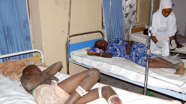 Victims of  a suicide bomb attack at a refugee camp receive treatment at a hospital in  Maiduguri, Nigeria, on Wednesday.