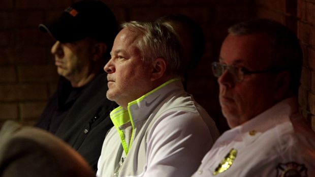 Former Ferguson police chief Tom Jackson listens quietly in the back of the room at a Ferguson city council meeting on ...