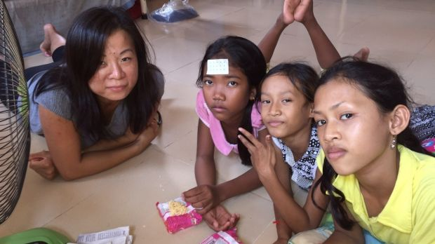 American volunteer Ame (left) with three of 65 children at the Poor Street Children and Orphans Training Centre in a ...