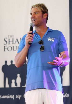 Shane Warne speaks during the Shane Warne Foundation family day at Luna Park in December 2013.