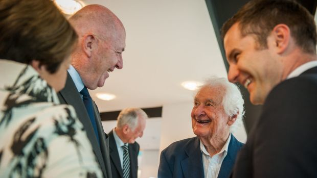 Retired Treasury official Neil Davey (second from right), 95, of Torrens, known as Mr Decimal for his role in crafting ...