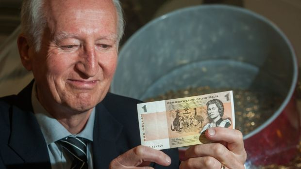 Canberra author Peter Rees at the Royal Australian Mint with a $1 note he received in his first pay packet in the same ...