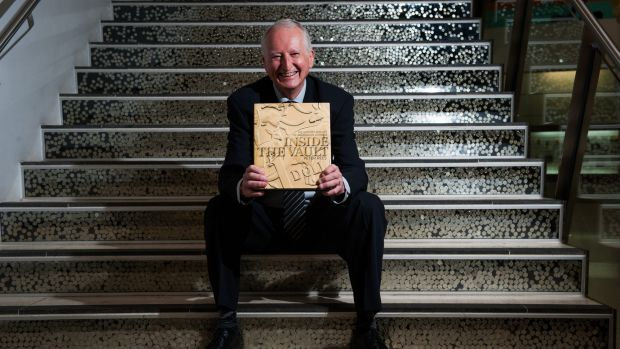 Canberra author Peter Rees at the Royal Australian Mint with his book Inside the Vault: The history and art of ...