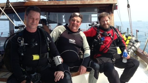 In the summer of 2013, Australian diver Frank Craven, (centre) was diving with a group on the wrecks of the USS Houston ...