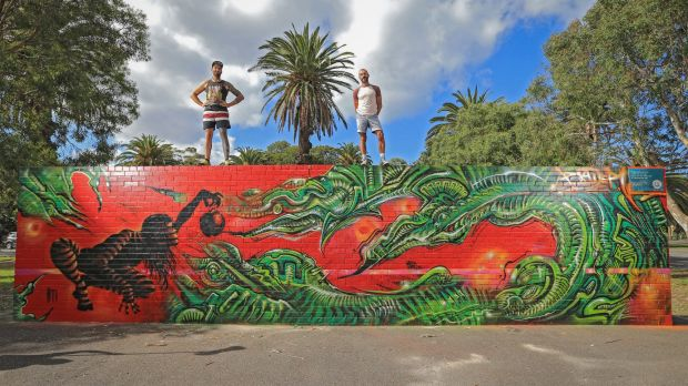 Street artists Paul Round (left) and Frank Maiorana with their mural at Peanut Farm Reserve in St Kilda.