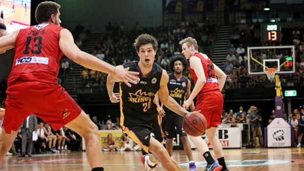 Rookie on the run: Kings guard Indiana Faithfull takes on the Perth defence.