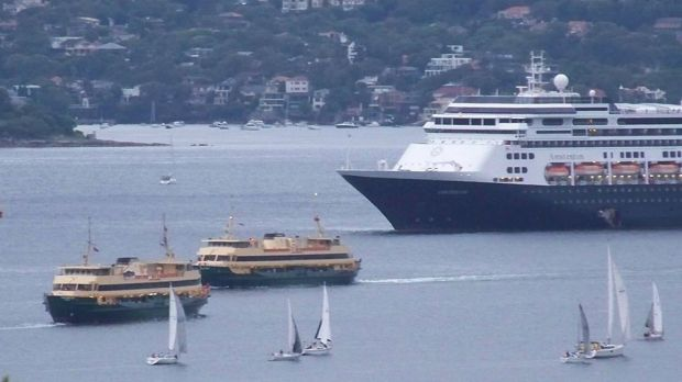 Sydney ferries Freshwater and Collaroy slowed as they passed the stationary cruise ship.