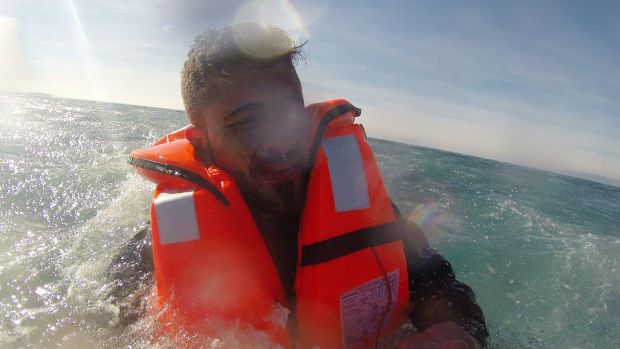 Safe for now: Pelen Hussein is rescued by the Turkish Coast Guard.
