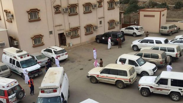 Ambulances and police vehicles are seen outside of the Ministry of Education office, located in Al-Dayer, Jazan region, ...