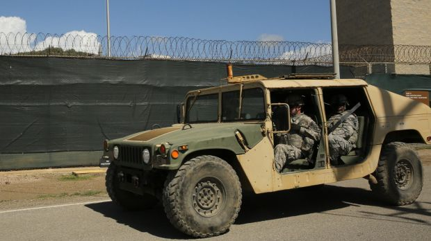 Military personnel patrol outside Camp 6 at Guantanamo Bay earlier this month.