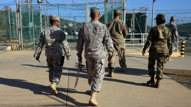 Military guards leave Camp Delta at the Guantanamo Bay detention centre earlier this month.