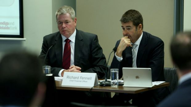 Bendigo and Adelaide chief executive Mike Hirst (left) and chief financial officer Richard Fennell the first half of ...