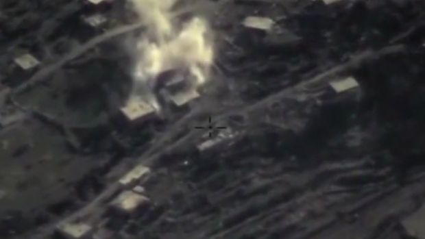 An air strike on a militant base in the province of Latakia, Syria, in an image taken from footage posted on the Russian ...