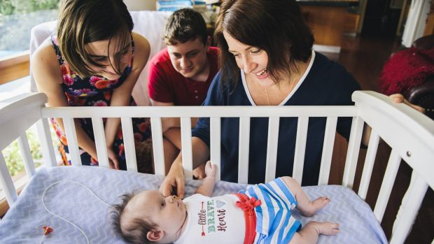 Three-month-old Charlie Clode with his family, Melissa, Lily (12), and William (14), at home in Bruce.