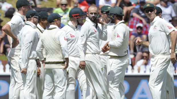 Nathan Lyon and Australia celebrate a wicket.