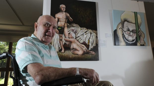 """Founding creator of the Bald Archy Prize, Peter Batey, with two of his favourite entries: """"The Break Up"""" by James ..."""