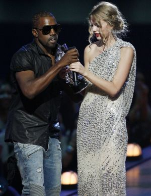 Kanye West takes the microphone from singer Taylor Swift during the MTV Video Music Awards in 2009.