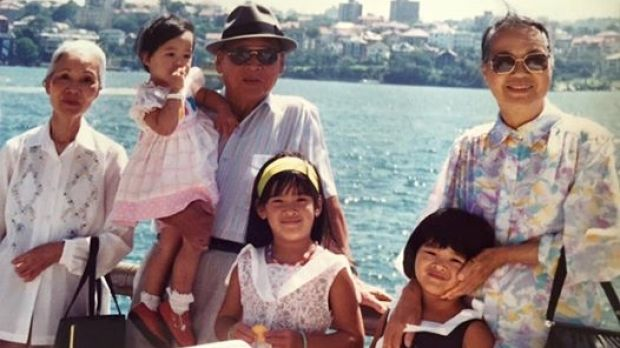 Giselle (front) with her Bà Nội, sister Arielle, paternal grandfather Ông Nội, sister Cybelle, and Bà Ngoại. It was ...