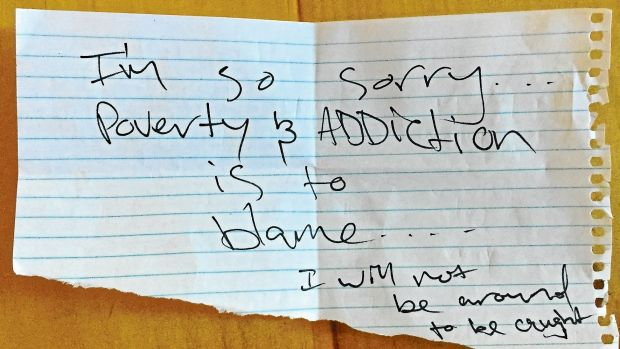 A note left by thieves who broke into the Byng Street Local Store and Cafe.