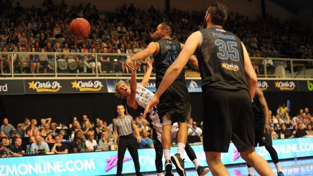 Melbourne United's Kyle Adnam is fouled by New Zealand's Tai Wesley.
