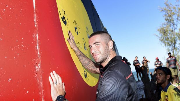 Healing hands: Indigenous All Stars player Joel Thompson on Stradbroke Island.