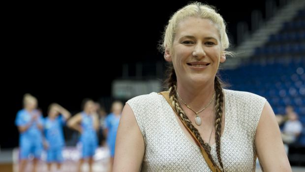 Lauren Jackson accepts a farewell gift on Friday night.