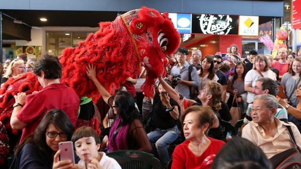 Hundreds of people enjoy the 2016 Chinese New Year Parade and dances at the Chinatown Mall in Fortitude Valley.