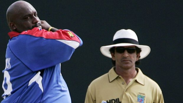 Banned: Umpire Asad Rauf (right) has been handed a five-year suspension.