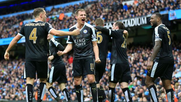 Foxes in the hunt: Leicester City's Marc Albrighton (centre) celebrates after Robert Huth scores his side's third goal ...